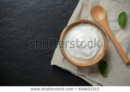 Romig saus houten kom voedsel Stockfoto © Digifoodstock