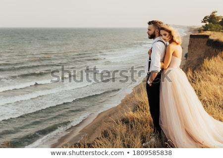 groom gently embracing his bride Stock photo © tekso