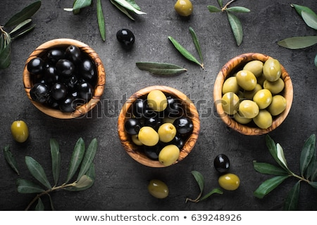 Bowl of green olives on table Stock photo © IS2