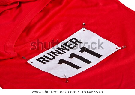 Runner pinning number to shirt Stock photo © IS2