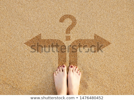 woman on beach with arrows in sand stock photo © is2