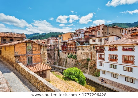 Rivier Spanje bergen hemel water boom Stockfoto © lunamarina
