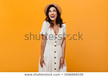 Portré töprengő fiatal lány nyár ruha másfelé néz Stock fotó © deandrobot