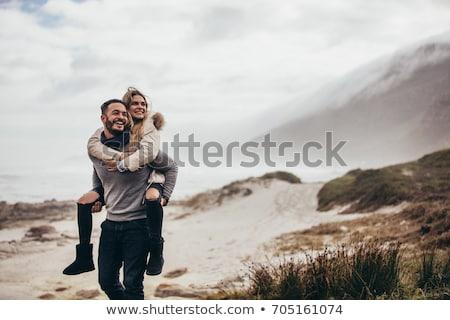Casal inverno homem namorada árvore diversão Foto stock © Lopolo