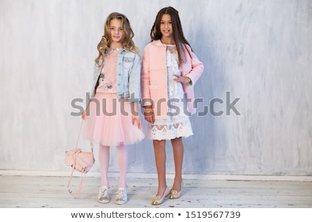 two cheerful young girls on on roller skates stock photo © deandrobot