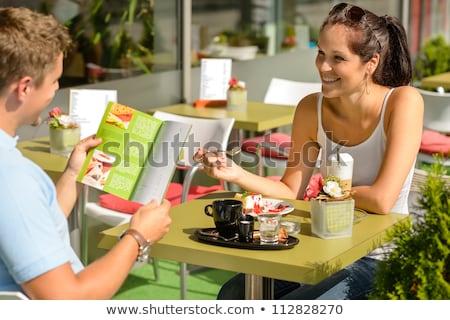 Boldog szerető pár ül kávézó tart Stock fotó © deandrobot