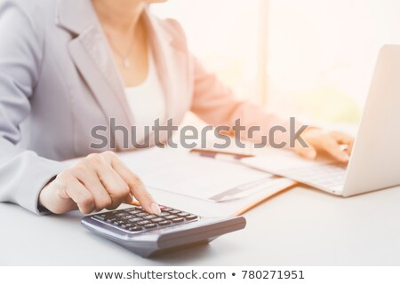 Stock fotó: business woman accountant or banker making calculations Bills. d