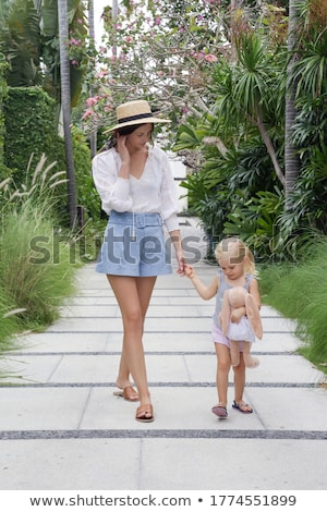 mother and daughter in a hat during the summer walks stock photo © elenabatkova