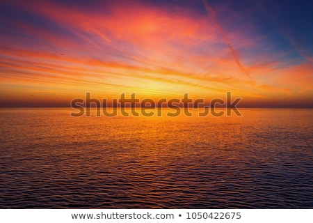 Dramatic Sky Over Sea At Sunset Stock photo © AndreyPopov