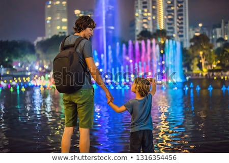 Fountain on the lake in the evening, near by Twin Towers with ci Stock photo © galitskaya