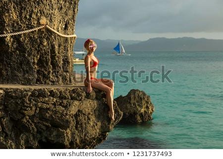 Kız kaya plaj gıda seksi güneş Stok fotoğraf © galitskaya