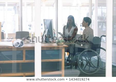 Yandan görünüş genç özürlü kadın yürütme konuşma Stok fotoğraf © wavebreak_media