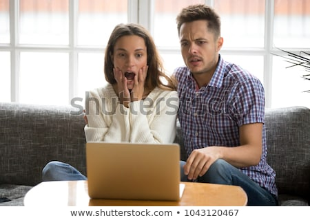 Man Watching Thriller Movie On Laptop Stock photo © AndreyPopov