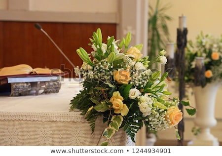 Holy Bible and Flowers on altar in the church Stock photo © val_th