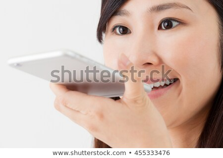 Black Woman Using Mobile Phone For Voice Mail Stock photo © diego_cervo