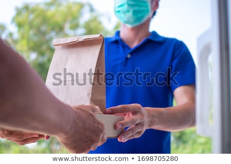Deliverly man pick up order Stock photo © vichie81