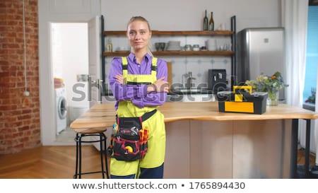 Encanador trabalhar uniforme foto bonito Foto stock © deandrobot