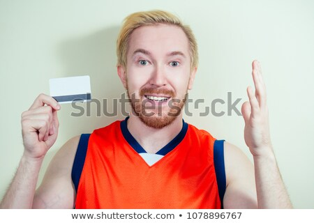 closeup portrait of business man holding business card in his mo stock photo © hasloo