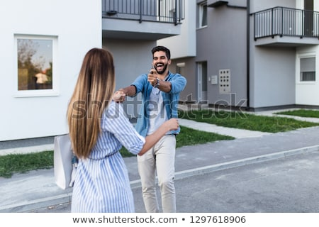 happy couple in front of a building Stock photo © photography33