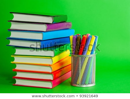 Stacks of colorful books and socket with felt pens Stock photo © AndreyKr