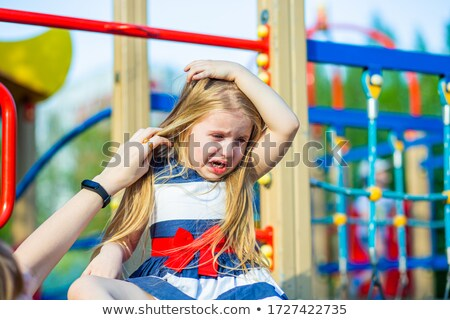 tired little blonde girl in a playground Stock photo © photography33