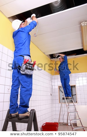 Electricians wiring a large tiled room Stock photo © photography33