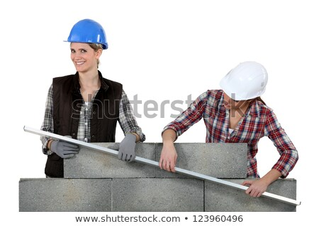 two craftswomen building a wall stock photo © photography33