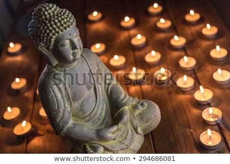 zen candle and buddha statue stock photo © sandralise