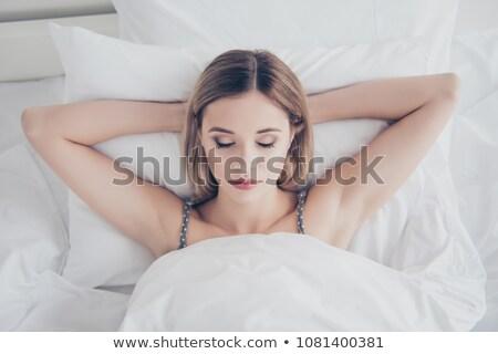 portrait · deux · beauté · jeunes · femmes · oreiller - photo stock © acidgrey