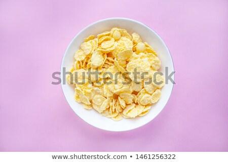 Cornflakes isolated on white background stock photo © deymos