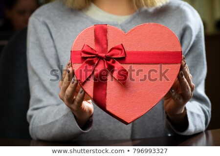 Girl holding a heart-shaped box Stock photo © photography33