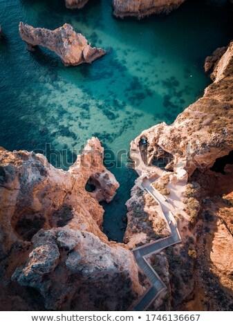 Boven zee water rock golf Stockfoto © dinozzaver