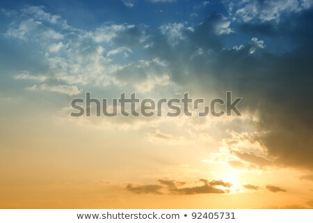 dramatic red blue sky on sunset evening vibrant colors nature stock photo © lunamarina