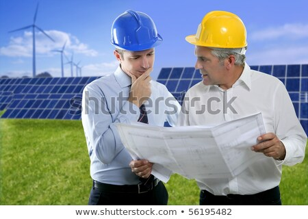 senior businessman work green grass solar plates stock photo © lunamarina