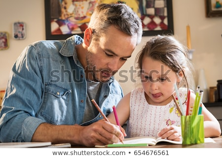 Family - child doing homework Stock photo © Kzenon