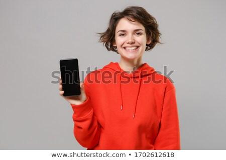 young woman wearing hoodie stock photo © hasloo