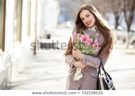 szépség · barna · hajú · köteg · virágok · lány · tavasz - stock fotó © dolgachov