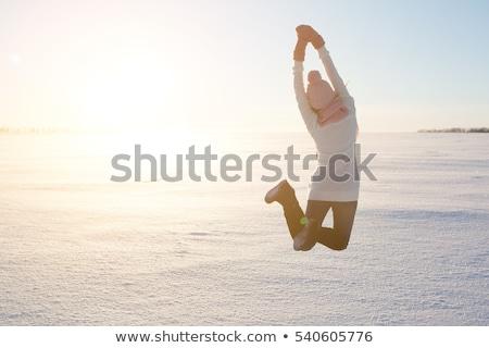 Kış kız atlama mutlu esmer güzel Stok fotoğraf © DNF-Style
