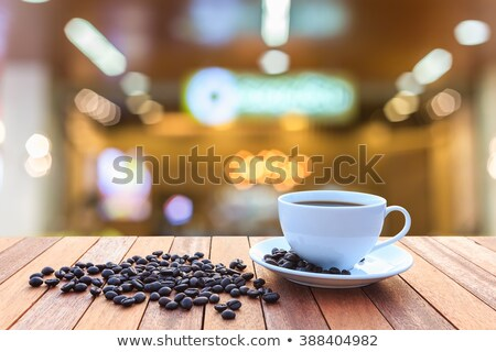 close up coffee cup on blurry wood table background stock photo © yanukit