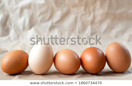 Food background with different eggs on craft paper Stock photo © dariazu