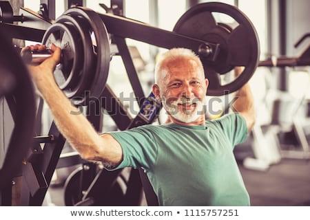 зрелый человек гантели белый человека работу Сток-фото © AndreyPopov