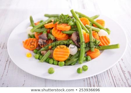 Főtt zöldségek tányér finom piros kerámia Stock fotó © andreasberheide