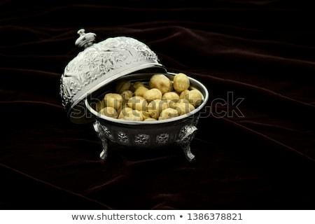 Plenty of ripe hazelnuts on plate Stock photo © stevanovicigor