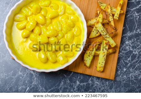 Curry gnocchi with bhajjis and roasted potato Stock photo © Peteer