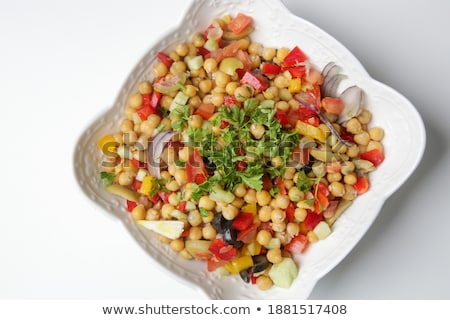 Green wheat and mixed salad with chickpeas in a bowl. Homemade healthy food  lots of seasonings Stock photo © frimufilms