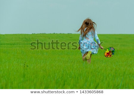 Young girl running with windmill Stock photo © IS2