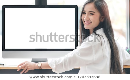 Beautiful woman working on desktop pc Stock photo © wavebreak_media