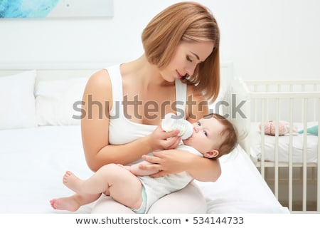 mother feeding baby stock photo © is2