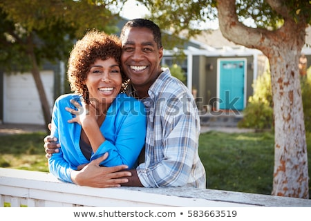 Middle aged couple, back to back Stock photo © IS2