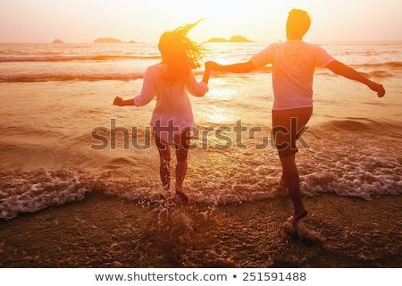 Сток-фото: пару · работает · волны · пляж · женщину · весело